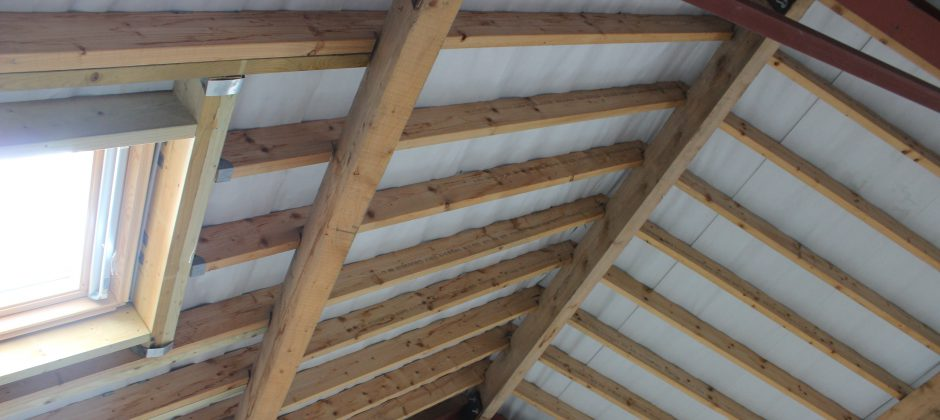 Property with beams exposed after timber restoration
